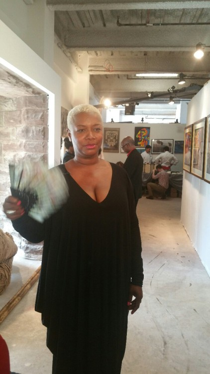 "Dianna Smith a visual artist at Flux Art Harlem VIP reception gives a visual voice to things that concern her personally. ""I wonder as wander"" inspired by Langston Hughes during his travel in 20th century."