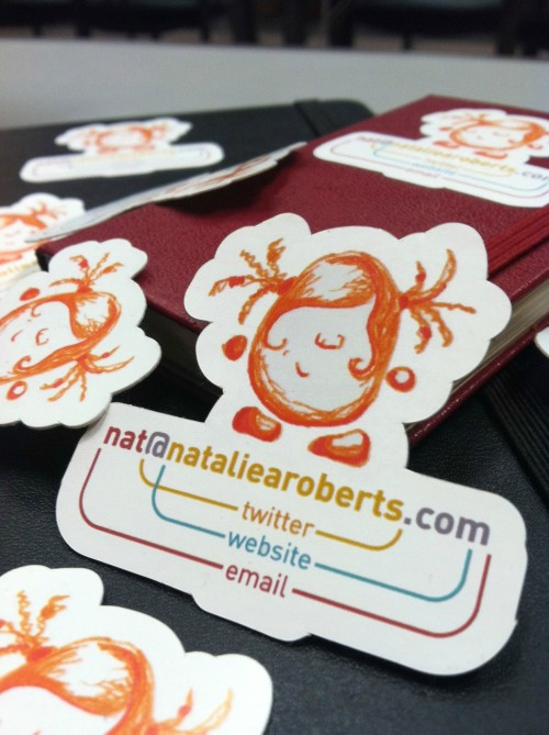 Clever business card by natalie a. roberts providing her twitter username, her website & her e-mail adress all in one.
