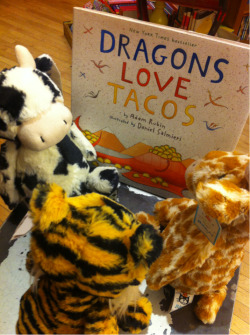 "STAFF PICK (15% OFF!) - Dragons Love Tacos by Adam Rubin To quote the book, ""If you want to make friends with dragons, tacos are key."" Who knew that dragons liked tacos so much! All different kinds, as varied as your imagination. Oh but wait! they don't like their tacos with spice so no salsa, ok? Mild ingredients only. And dragons like parties too! But taco parties are their favorite kind of parties. If you want to make friends with dragons, throw a taco party, ok? But what happens if you have all your dragon friends over for a taco party and a little bit of spicy salsa gets snuck in? Read the book to find out the explosive ending to this story… (Rebecca)"