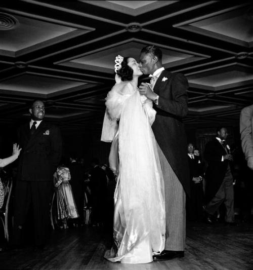 "Nat ""King"" Cole and Maria Cole dance at their wedding reception 65 years ago today, March 28, 1948, which happened to be Easter Sunday. The Coles were married at Harlem's famous Abyssinian Baptist Church by Rev. Adam Clayton Powell, Jr., the legendary Harlem congressman. According to Michael Henry Adams, author of the beautiful coffee table book, ""Harlem Lost and Found,"" Ms. Cole wore a $700 ice-blue satin dress designed by none other than VBG fashion designer legend, Zelda Wynn Valdes! Photo by Lisa Larsen/Time Life Pictures/Getty Images."