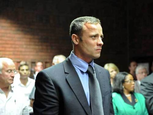 "nationalpostsports:  Oscar Pistorius admits shooting girlfriend Reeva Steenkamp, says he thought she was a robberOscar Pistorius says he shot his girlfriend to death by mistake, thinking she was a robber.The double amputee said in an affidavit read by his lawyer at his bail hearing Tuesday that he felt vulnerable because he did not have on his prosthetic legs when he pumped bullets into the locked bathroom door.Then he realized that model Reeva Steenkamp was not in his bed. He says ""It filled me with horror and fear …""He put on his legs, tried to kick down the door, then bashed it in with a cricket bat to find Steenkamp, 29, shot inside.He said he ran downstairs with her, but ""She died in my arms."" (STEPHANE DE SAKUTIN/AFP/Getty Images)  Olympian Oscar Pistorius faces his bail hearing. The prosecution contradicts his explanation of Steenkamp's death as an accidental tragedy fueled by his fear, asserting instead he killed her after an argument, and was wearing his prosthetic legs at the time. Pistorius has been charged with premeditated murder."