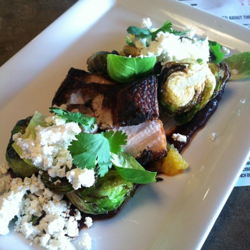 Pork belly, fried sliced, roasted Brussels sprouts, Sheep's milk feta, sprouts leaves in gnoc Cham, orange marmalade ancho pebil.