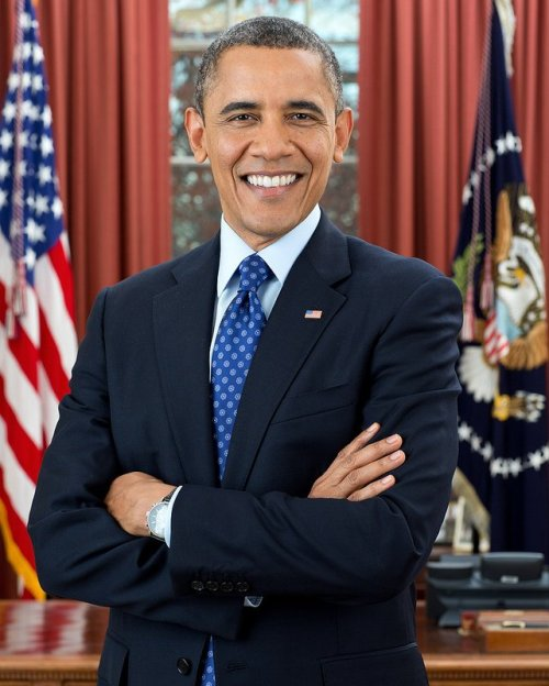 firstfamily:  White House releases new official portrait of Obama President Barack Obama is photographed during a presidential portrait sitting for an official photo in the Oval Office, Dec. 6, 2012. (Official White House Photo by Pete Souza)    d'aww Barack :D