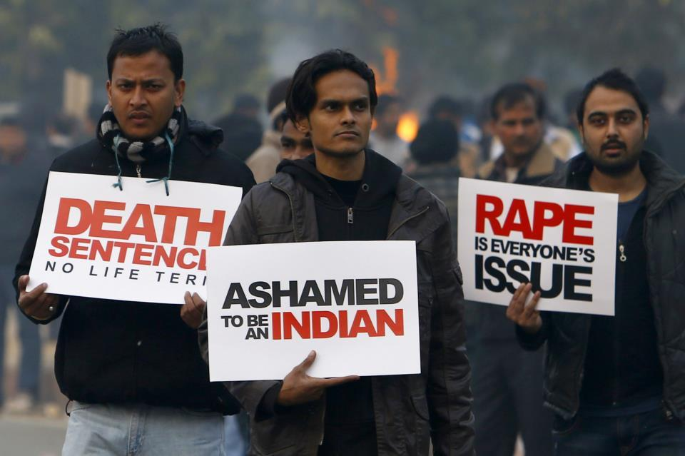 auzubillah:  Indian demonstrators walk with placards during a protest calling for better safety for women following the rape of a student last week, in front the India Gate monument in New Delhi on December 23, 2012. In the biggest protest so far, several thousand college students rallied at the India Gate monument in the heart of the capital where they were baton-charged, water cannoned and tear gassed by the police. AFP PHOTO/ TENGKU BAHARPress TV
