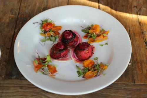 SCARLET SCALLOPS WITH BEETS THREE WAYS  This recipe is based on one from the stellar blog No Recipes for Scarlet Seared Scallops. Beets are so tied to winter and were fun to use for the marinade for the scallops to make them a bright and bodacious burgundy hue. Sweet reddish scallops lay a top Pickled Chiaooga Beets which are surrounded by a Roasted Gold Beet Salad with Pea Shoots and Pear Dressing. An artistic dish for a food styling photography assignment.