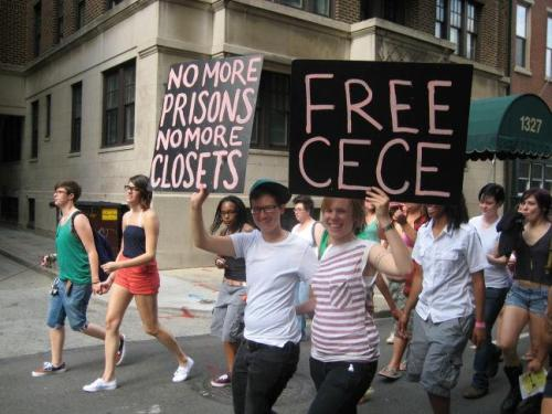 "'No more prisons! No more closets! FREE CECE!'photo credit: Robin Marklephoto information from Robin Markle:June 9, 2102Philadelphia Dyke MarchPhiladelphia, PA, USphoto caption from Robin Markle:""Layne Mullet & Sarah Small of Decarcerate PA hold signs of support for CeCe at the Philadelphia Dyke March.""++++Between now and trial I am posting a photo a day to FREE CECE NOW![for information about CeCe McDonald's struggle, explore: supportcece.wordpress.com]Thank you to the photographers/artists/activistswho are contributing photo/s to an onlineSLIDE SHOW DEDICATION to FREE CECE McDONALD—entitled ""This is what solidarity looks like!""The dedication will be part of the May Day 2013free online publication of the 20th-anniversaryauthor edition of Stone Butch BluesPlease make your own individual and group photosin support of CeCe's struggle for the slide showtitled ""This is what solidarity looks like!""FREE CECE NOW!!Photo information/photo credit forms:Facebook:https://www.facebook.com/notes/leslie-feinberg-on-facebook/stone-butch-blues-multi-media-digital-dedication-to-free-cece-mcdonald/486837591335592Tumblr:http://leslie-feinberg.tumblr.com/IACenter.org:http://iacenter.org/lgbt/cecemcdonaldpictures/"