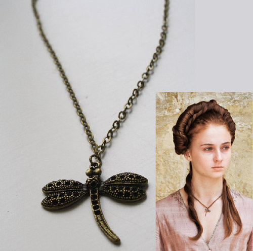 bijouxmalou:  Sansa Stark Game of Thrones Inspired Dragonfly Necklace I was inspired to make a dragonfly pendant necklace, by the necklace the character Sansa Stark worn in the Game of Thrones. This was a short pendant necklace with a dragonfly. I made a bronze interpretation of this necklace (be aware that this is not a replica, it is simply inspired by it)This necklace has a 4cm long dragonlfy attached to a short chain. In the widest part the dragonfly is also about 4cm…. Find this on Etsy