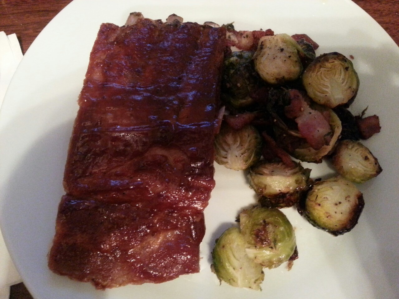 Dinner's on! Pork ribs and brussels sprouts with bacon.