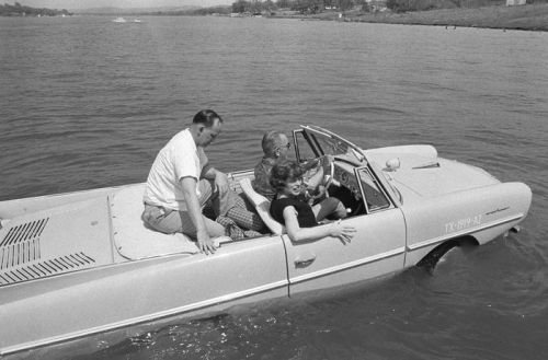 sunsetgun:  Car nut LBJ in his Amphicar. Along with his Lincoln Continental convertibles, 1934 Ford Phaeton, Jolly 500 Ghia and his golf carts, Johnson owned a 1915 fire truck because, why the hell not? He also owned a donkey cart for his two donkeys, Soup and Noodles.