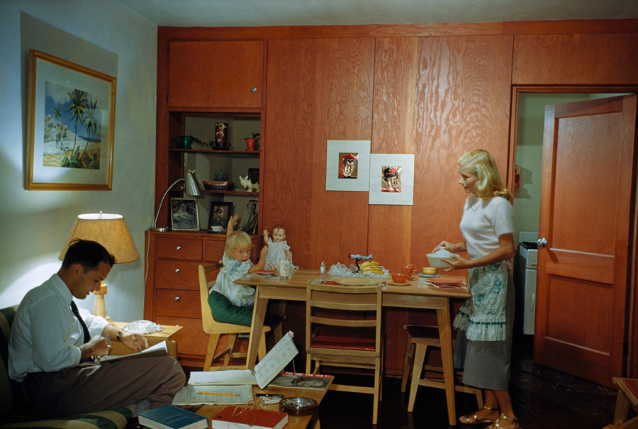 oldflorida:  Domestic bliss at the U, 1950. natgeofound:  A married student studies as his wife serves dinner to their daughter in Coral Gables, Florida, November 1950.Photograph by Volkmar K. Wentzel, National Geographic