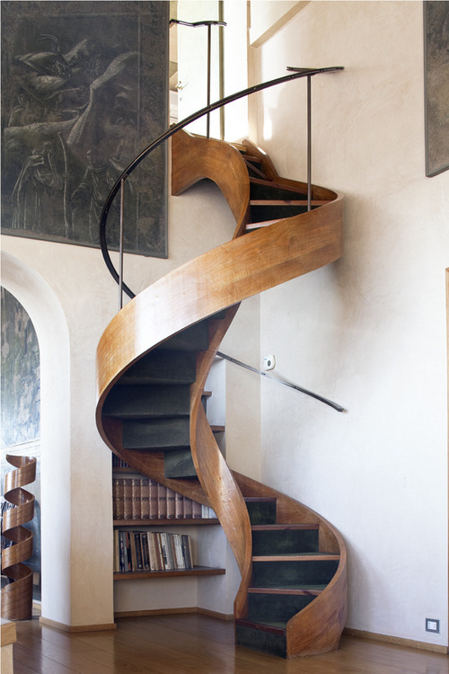 myidealhome:  stunning wooden winding staircase   This looks like it was literally made out of a tree.