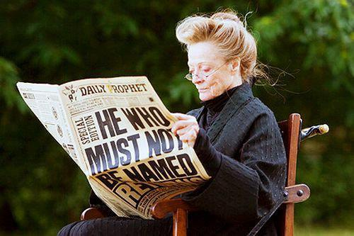 freakswilltakeover:  this is Maggie Smith in her costume out of characterin a chairreading the daily prophet your argument is invalid