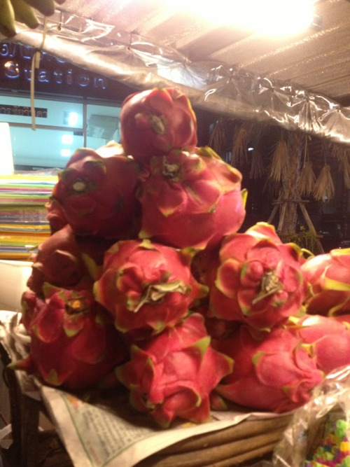 Pitahaya   This exotic marvel that we, at the dot com, present to you today has baffled our tongues, eyes, and soul for sporadic fortnights. Commonly known as the Dragonfruit, this Cambodian candy would seemingly fancy anyone's palate with the appearance of fire and spice that only Khaleesi could bring.   We had searched this supple dusty flavored fruit for years only to be consistently saddened by the lack luster nature. From Barcelona to Bangkok, it fell. We attempted to avoid this review, hiding from our duty. For that we apologize and have failed you. It is the extreme disappointment of a crushed dream that could permit this desertion. Judging a book by its cover is indeed an impossible myth to bust.   The Dragonfruit is pink, green and red with excitement on the surface. However once peeled, the true boredom of grey pulp and fiber(ous) seeds will leave your anxious palate feeling like you licked a pallet.   All that aside, I'm sure Cambodia is a lovely place.   With love and adoration, THE DOT COM TEAM