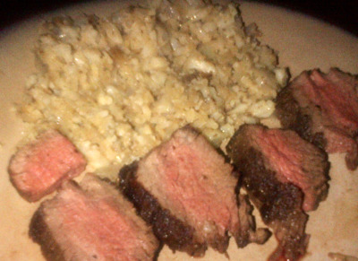 Filet Mignon with Cauliflower Hash Browns  Ingredients: ½ head of Cauliflower 1 tsp. Paprika 1 tbsp. Parsley 2 cloves Garlic 3 tbsps. EVOO 4 (6 oz.) Filet Mignon, or beef of choice Salt & Pepper, to taste  Make: Break cauliflower into small pieces and mash or place into food processor to break up.   Heat 2 tbsps. EVOO in large pan, over medium heat.  Once hot, add in pieces of cauliflower, in a single layer.   After about 3-4 mins, cauliflower should start to brown.  Add in salt and garlic and coat cauliflower completely.  Simmer for about 3 to 5 mins, stirring occasionally.  Remove from heat and stir in parsley and paprika.  In a separate pan, heat additional EVOO until hot.  Season beef with salt & pepper.  Sear each side, in the pan, until preferred temperature.
