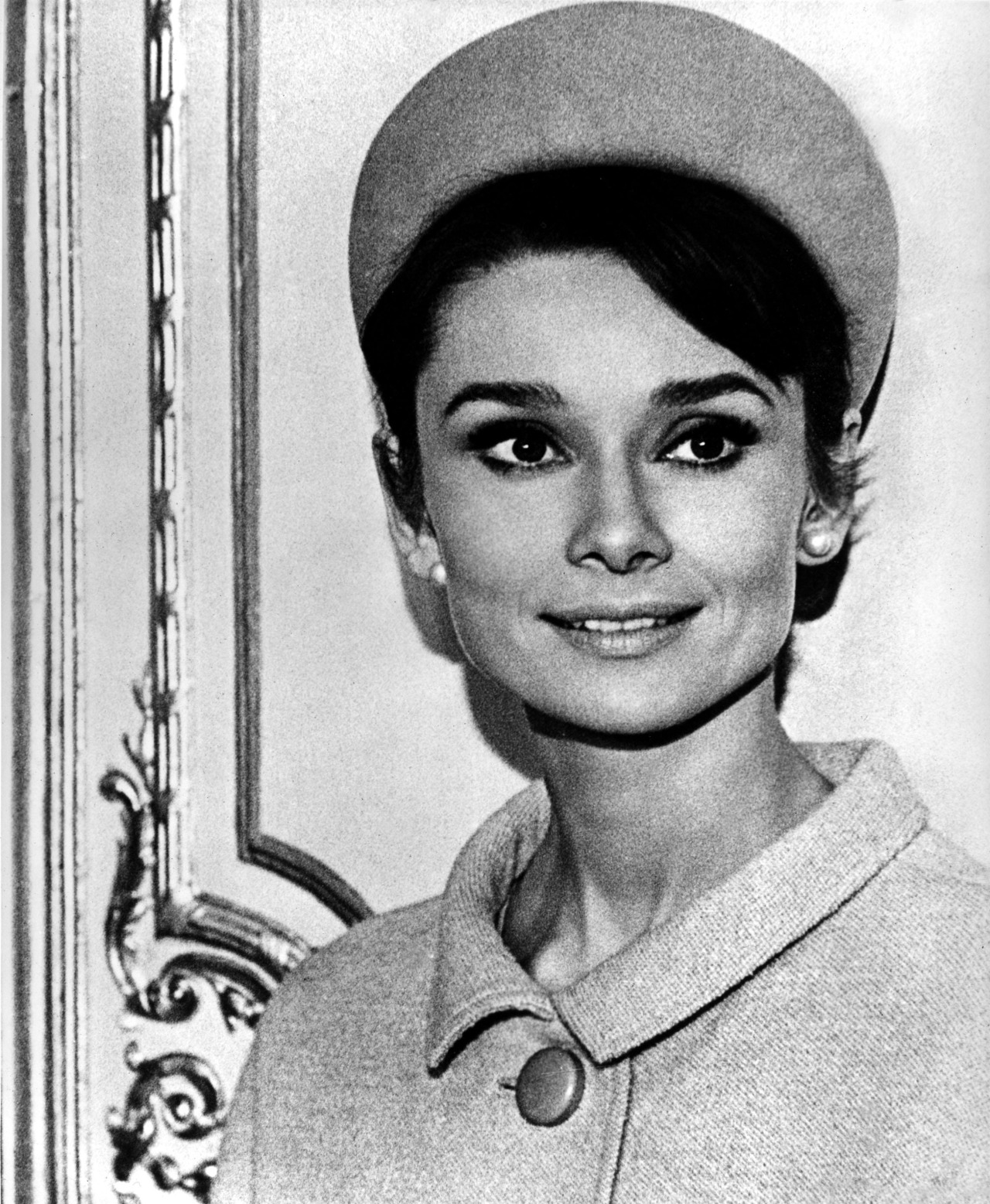 "The actress Audrey Hepburn photographed by Vincent Rossell during the filming of ""Charade"" in Paris (France), in November 1962. -Audrey was wearing creations of Givenchy (hat and coat of ivory wool, of his collection for the Autumn/Winter 1962/63)."