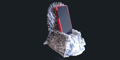 "HBO Blocks 3-D Printed Game of Thrones iPhone Dock The tiny, detailed, 3-D printed Iron Throne iPhone dock is no more, thanks to a cease-and-desist letter from HBO, which owns the rights to the Game of Thrones series.   Fernando Sosa, who modeled the throne in Autodesk Maya based on still images from the series, began selling it beside other 3-D printed sculptures on his site, nuPROTO.com. But while it was still in pre-order, HBO found out. ""I guess it kind of snowballed in publicity,"" says Sosa. ""I didn't think it would get this big. And all of a sudden, we got a letter from HBO."" That letter told him to knock it off, asserting rights not just to the series or the throne, but to replicas inspired by it. ""While we appreciate the enthusiasm for the Series that appears to have inspired your creation of this device, we are also concerned that your iron throne dock will infringe on HBO's copyright in the Iron Throne,"" says the letter. (via HBO Blocks 3-D Printed Game of Thrones iPhone Dock 