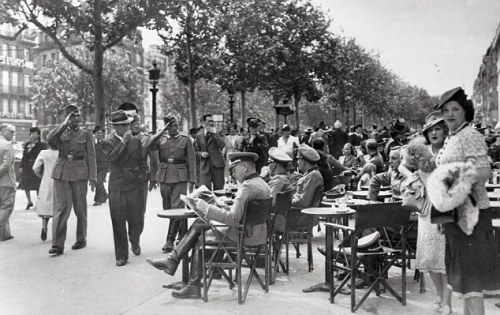 German soldiers sit outside a Paris cafe on the Champs Elysees on Bastille Day in 1940