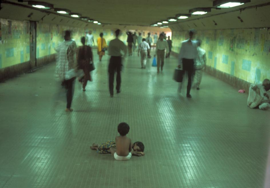 homeless brothers go ignored in bombay central station. mumbai, 1995. photo raghu rai