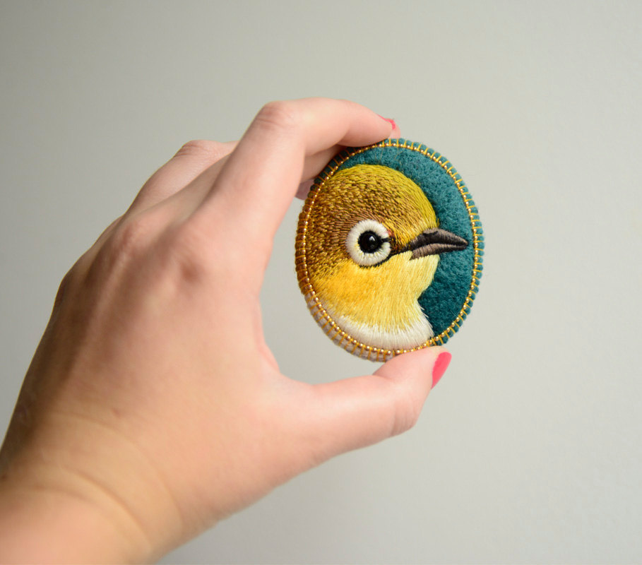 sosuperawesome:  Embroidered brooches by cOnieco