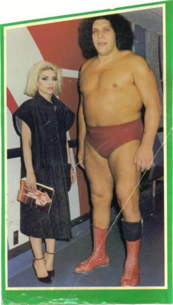"Debbie Harry and Andre the Giant Hot lady, big dude.  Whenever Andre treated someone to a meal in a restaurant, he would pay, but he would also insist on paying when he was a guest. After one meal, Arnold Schwarzenegger had quietly moved to the cashier to pay the check before Andre could, but then found himself being physically lifted, carried back to his table and deposited in his seat by Andre, who stated emphatically, ""I pay"". (from Wikipedia) Hey yo, follow Rad Recorder."