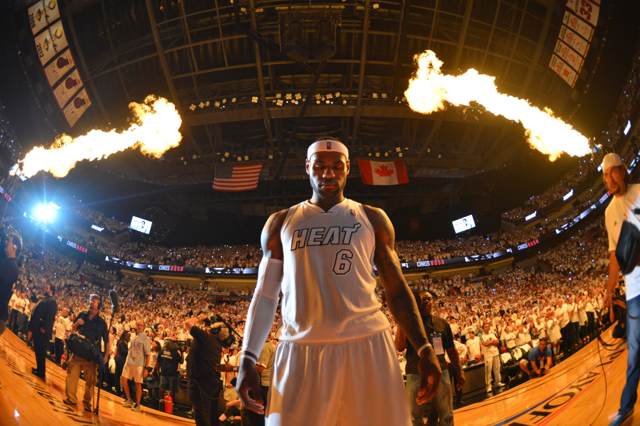 nba:  LeBron James of the Miami Heat enters the court prior to the match up against the Milwaukee Bucks in Game One of the Eastern Conference Quarterfinals during the 2013 NBA Playoffs on April 21, 2013 at American Airlines Arena in Miami, Florida. (Photo by Jesse D. Garrabrant/NBAE via Getty Images)