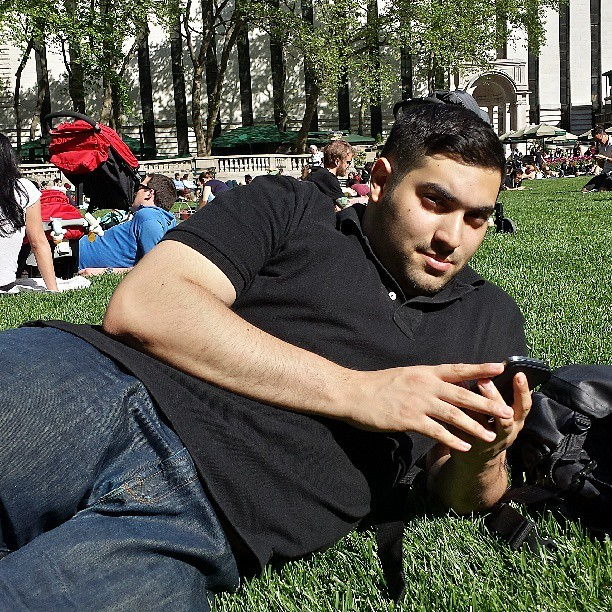 Me laying in the grass at Bryant Park. #BryantPark #nyc #instagay