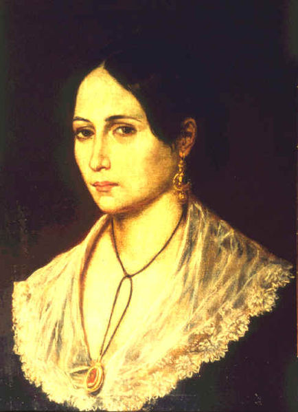 "Ana Maria de Jesus Ribeiro di Garibaldi, best known as Anita Garibaldi, (August 30, 1821 – August 4, 1849) was the Brazilian wife and comrade-in-arms of Italian revolutionary Giuseppe Garibaldi. Their partnership epitomized the spirit of the 19th century's age of romanticism and revolutionary liberalism. Ana Maria ""Anita"" de Jesus Ribeiro was born into a poor family of Azorean Portuguese descent, herdsmen and fishermen in Laguna in the southern Brazilian state of Santa Catarina, a year prior to that country's independence from Portugal. In 1835, at the young age of fourteen years, Anita was forced to marry Manuel Duarte Aguiar, who abandoned her to join the Imperial Army. Giuseppe Garibaldi, a Nicois sailor of Ligurian ascent turned Italian nationalist revolutionary, had fled Europe in 1836 and was fighting on behalf of a separatist republic in southern Brazil (the War of the Farrapos). When young Garibaldi first saw Anita, he could only whisper to her, ""You must be mine."" She joined Garibaldi on his ship, the Rio Pardo, in October 1839. A month later, she received her baptism of fire in the battles of Imbituba and Laguna, fighting at the side of her lover. A skilled horsewoman, Anita is said to have taught Giuseppe about the gaucho culture of the plains of southern Brazil, Uruguay, and northern Argentina. One of Garibaldi's comrades described Anita as ""an amalgam of two elemental forces…the strength and courage of a man and the charm and tenderness of a woman, manifested by the daring and vigor with which she had brandished her sword and the beautiful oval of her face that trimmed the softness of her extraordinary eyes.""  (Anita dressed as a man) In 1841, the couple moved to the Uruguayan capital of Montevideo, where Giuseppe Garibaldi worked as a trader and schoolmaster before taking command of the Uruguayan fleet in 1842 and raising an ""Italian Legion"" for that country's war against Argentine dictator Juan Manuel de Rosas. Anita participated in Garibaldi's 1847 defense of Montevideo against Argentina and his Uruguayan allied former dictator Manuel Oribe. Anita and Giuseppe were married on March 26, 1842, in Montevideo. They had four children, Menotti (1840–1903), Rosita (1843–1845), Teresita (1845–1903), and Ricciotti (1846–1924). Anita was carrying their fifth child when she died. Anita remained a presence in Garibaldi's heart for the rest of his life. It was perhaps with her memory in mind that, while traveling in Peru in the early 1850s, he sought out the exiled and destitute Manuela Sáenz, the fabled companion of Simón Bolívar. Years later, in 1860, when Garibaldi rode out to Teano to hail Victor Emanuel II as king of a united Italy, he wore Anita's striped scarf over his gray South American poncho."