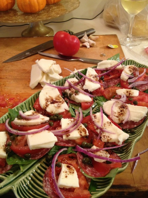 Cooking with friends: Making caprese salad with salami and capers