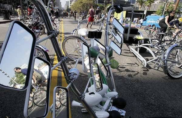 "latimes:  Biking in L.A. - it's possible! Even for a transplanted Midwesterner like our own Ben Poston, who writes about his experiences learning to maneuver around the city aided by neither car nor public transportation. It's not just the lack of traffic that's enboldened Poston's faith the viability of biking in L.A.  Riding at a pace between 15 and 20 mph, the city is a slide show instead of a blur. I mentally catalog the names of the food trucks, carwashes, coffee shops and thrift stores tucked into strip malls that line Sunset. I watch people congregating around the bus stop at the Echo Park Avenue intersection and can even hear snippets of conversations from sidewalk cafes. (""I finally got a TV credit. Everything else is gravy, right?"")  Read Poston's full perspective here, and maybe begin thinking about dusting off your own bike and helmet."