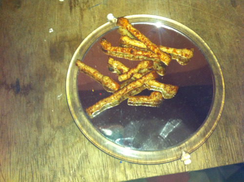 Twiglets on a mirror. From Cesca at Dalston Lane.