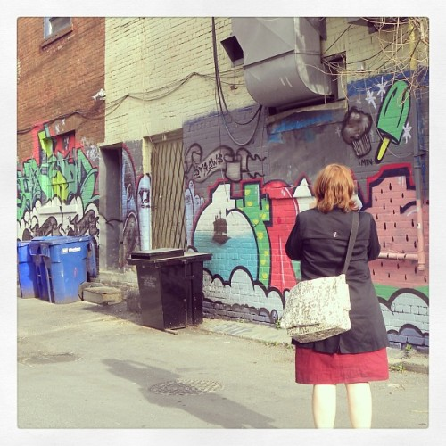 Me shooting @kellyoyo shooting some graffiti in our new 'hood.