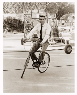 "Sean Connery riding a bike. Still awesome. putthison:  Lower Your Tie Clip I like this photograph of Sean Connery on a bicycle for a lot of reasons. It's not only amusing to me, but gives you an idea on how well-fitting clothing allows you to move. It illustrates that ""fit"" doesn't exactly mean ""ultra slim"".  But there is a small detail worth pointing out in this photo about the functionality of accessories, too. Notice Connery's tie clip is positioned about half way down his shirt — as I think it should be.  I've noticed a lot of guys wearing their tie clips up higher — presumably to show them off — but the tie clip becomes more irrelevant the further up it travels toward your neck. A tie clip (or tie bar, tie tack or tie pin) should help keep your tie flat against your chest as you wear it, especially without a jacket. This helps keep it from getting in your way as you lean over to do work, eat, or in this case ride a bike without having the wind flap the tie's blades in your face.  (Photo via fuckyeaholdhollywood, which I've really enjoyed recently.) -Kiyoshi"