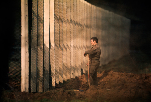 natgeofound:  An East German man standing near the Berlin Wall, September 1974.Photograph by Gordon Gahan, National Geographic
