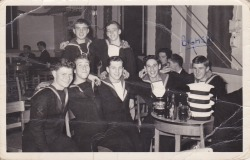 cynicalcunt:  Sailors, circa 1956. The photo was taken by my grandad and the guy on the end marked with 'Bighead' was my nan's ex-boyfriend. This has been in a family album for years and none of us had noticed the writing.