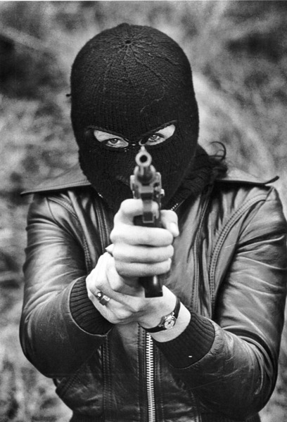 collectivehistory:  Female member of the Provisional IRA, 1975.  Balaclava chicks and guns, what's not to like?