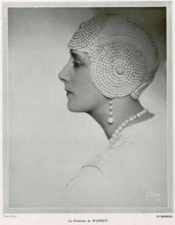kittyinva:  The Comtess de Wangen in a spectacular evening cloche, 1928.