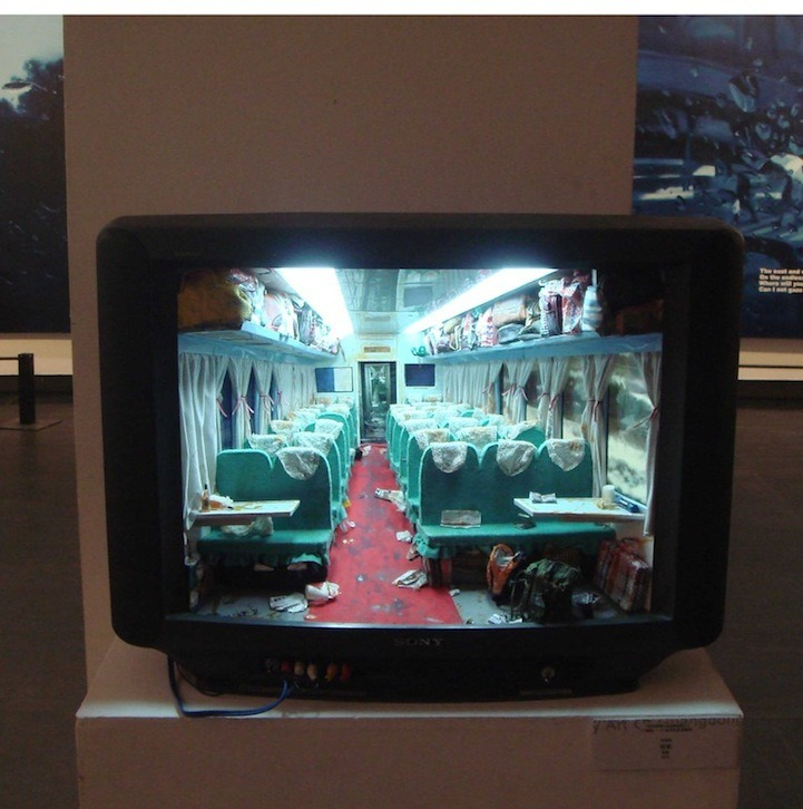Zhang Xiangxi builds rooms inside old TVs.