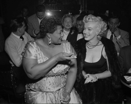 "noseasboba: I never get tired of this photo. Ella Fitzgerald was not allowed to play at Mocambo because of her race. Then, one of Ella's biggest fans made a telephone call that quite possibly changed the path of her career for good. Here, Ella tells the story of how Marilyn Monroe changed her life: ""I owe Marilyn Monroe a real debt… she personally called the owner of the Mocambo, and told him she wanted me booked immediately, and if he would do it, she would take a front table every night. She told him – and it was true, due to Marilyn's superstar status – that the press would go wild. The owner said yes, and Marilyn was there, front table, every night. The press went overboard. After that, I never had to play a small jazz club again. She was an unusual woman – a little ahead of her times. And she didn't know it."""