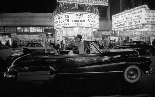bygoneamericana:  Saturday night in Times Square. New York, 1957. By Harold Feinstein