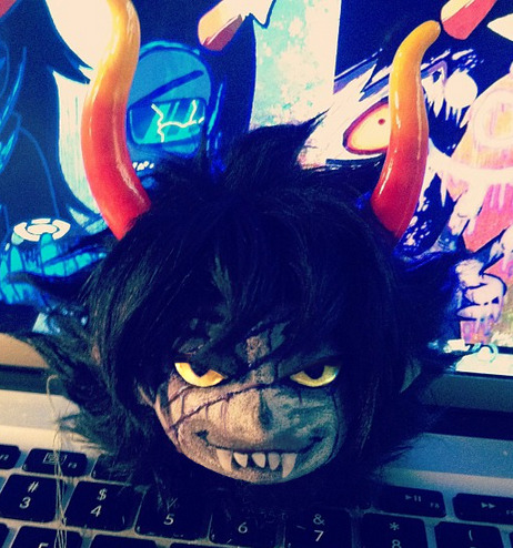 pukind:  first shot of finished gamzee head UuU weeeeeeeeeeee. Took me a while to get his eyes to cooperate but I actually got his eyes with cloth eyelids! wooo!   Like Karkat, his expression changes depending on what angle you view him at. I kind of like this Downward Evil Honk face.  if you view him from a lower angle he's got his illicit chill on.   pu is awesome txt it