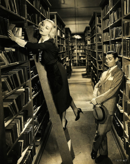 "the-dark-city:  Clark Gable admires Carole Lombard's legs in ""No Man Of Her Own"" (1932)"