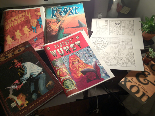 things that idly litter my workspace today: Proof of Future Shock 4(May TCAF release) Proof of Best of the Worst(who knows when release) First Heavy Metal i ever did own  Inks for a Kid Space Heater comic-KSH comics dont come naturally these days, keep poking at it at then leaving it on the shelf for months, not sure why… Doug Wildey's Rio, bought that from some guy on the street today Thomas Pynchon's Mason & Dixon which is very good, more dense then expected