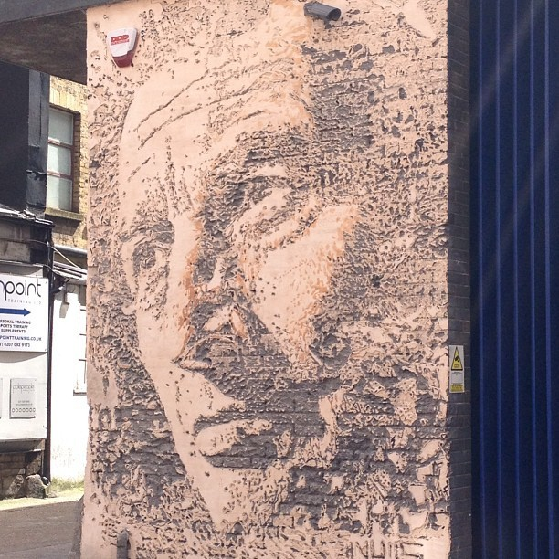 Most impressive of the day by Vhils. Did this with a jack hammer onto plaster and brick!