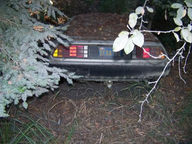 highway62:  crisperthanthou:  destroyed-and-abandoned:  Abandoned DeLorean in the woods of Northern California  FORGOTTEN TIME MACHINE  DO NOT DISTURB UNTIL 2015. Signed, Doctor Emmett Brown.