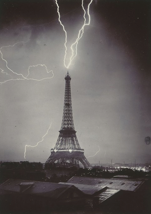 lmprovident:   The Eiffel tower struck by lightning, 1902 - Photograph by Gabriel Loppé