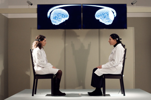In this real-time brain installation and science experiment, the audience takes on the role of performer and scientific subject. Volunteers engage in silent mutual gaze while their brain activity is displayed in real time, giving insight into their evolving internal experience as well as moments of neural synchrony. The installation continues Abramović's exploration of human connectedness through non-verbal communication. Following her durational performance The Artist is Present (MoMA 2010), it investigates the transfer of energy between performer, public, and participant.  http://kiblix.org/kiblix2012/softcontrol/?p=4