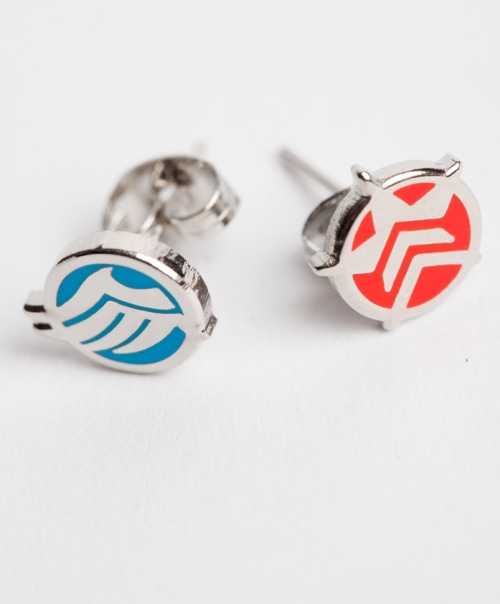 queendread:  omegafour:  pwnlove:  Mass Effect Merch Get your hands on a pair of earrings ($15.99), medallions ($24.99), and shirts ($19.99) all part of the new official Mass Effect collection from Sanshee. (via sanshee)  I HAVE A MIGHTY NEED!!!  I need that Renegade broach like RIGHT FUCKING NOW to go with my earrings and necklace by Land of Rapture.