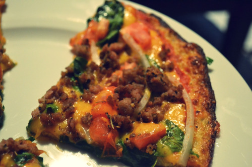 "Cauliflower pizza for dinner! om nom nom. Cauliflower pizza dough topped with sauce, sharp cheddar, spinach, onions, tomatoes, and italian seasoned ground turkey. recipe here. best one i've come across so far.  Cauliflower Pizza Dough 1 head of raw cauliflower (you won't use it all but you can freeze it for the next time a pizza craving strikes) 1 cup shredded parmesan 1 egg 1/2 tsp garlic 1 tsp mrs. dash garlic and herb  pizza sauce, cheese, and your favorite toppings remove stem from head of cauliflower and cut off florets. place in food processor and pulse until it looks like rice or grain. (do not puree!) place 1 cup of riced cauliflower in a microwave safe bowl and cook on high 2-3 minutes. remove and let cool. (you can cook all the cauliflower and freeze it in 1 cup portions for the next time you make pizza.) preheat oven to 450 degrees F. line a cookie sheet with foil and spray well with cooking spray. in a medium bowl combine 1 cup cooked cauliflower with parmesan cheese, egg, garlic, and mrs. dash. transfer mixture to cookie sheet and pat into a large, thin, round. make sure it is pressed together well. it should be about 1/4"" thick. bake for about 15 minutes but keep an eye on it. you want it to be browned all over and the edges to be really brown. let it cool for at least 15 minutes (this helps it become more solid). peel back foil from crust and then place the crust on a parchment paper lined cookie sheet. top with sauce, cheese, and your favorite toppings and bake just until cheese is bubbly (4-5 minutes)."