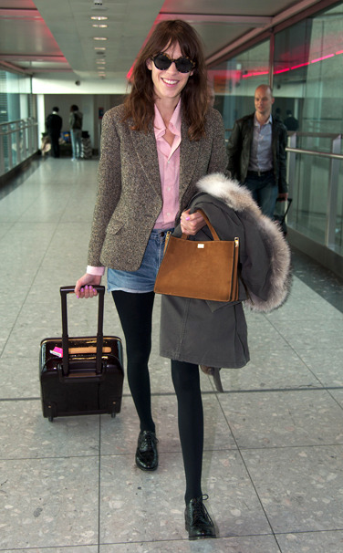 vogue:  Alexa Chung in A.P.C. shirt, Aquascutum blazer, Marni bag, Louis Vuitton suitcase, and Church's shoes.Vote for your favorite best dressed woman of the week.   This looks so good on her and would look so ridiculous on me. Whatever I'm trying shorts and tights in 2013! Somebody stop me!