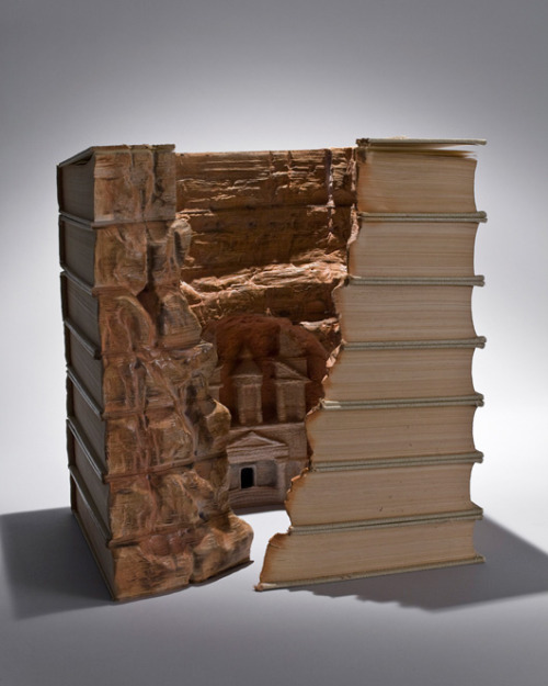 Artist carves vintage books into astoundingly intricate 3-D sculptures     Guy Laramee's work speaks to the 'erosion of cultures' and our over-reliance on analytical knowledge, symbolized by the book.